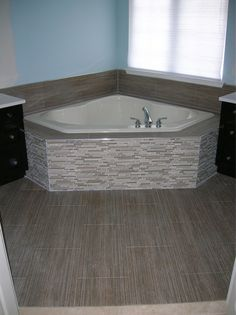 Corner Tub, Glass U0026 Stone Mixed Mosaic Front, Porcelain Tile Floor.  Designed And