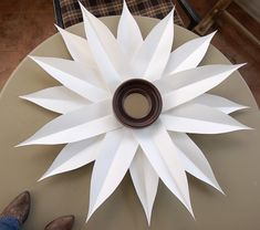 DIY sunburst mirror-a collection of them would be great in the girls' room