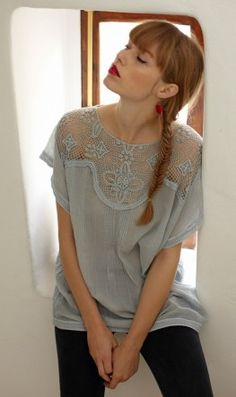 Pretty pale blue cotton voile blouse with delicate lace cut-work around the yoke. Straight cut tunic shape with cotton lace binding around sleeves and hems. Capped sleeves. This item is semi-sheer and may require a camisole underneath. L72cm cotton gentle wash 30'C  Code T1B098  $122.07