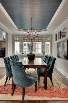 Great Neighborhood Homes | Parade of Homes Spring 2013 - reupholster G's mid-century chairs with this blue velvet. Tie in with tray ceiling in dining