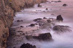 rocks surrounded mystical water , El Sunzal Beach, La Libertad, El Salvador