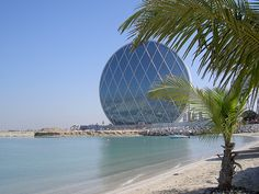 The newly constructed headquarters of Aldar Properties in Abu Dhabi has an eye catching circular shape. Abu Dhabi, Amazing Architecture, Modern Architecture, Cityscape Dubai, Circular Buildings, Architect Magazine, Surfboard, Skyscraper, Landscape