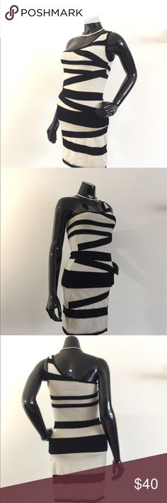 Bebe bandage bodycon dress Excellent condition. Material is durable making this piece very flattering on every body type ❤️ It is an asymmetrical neckline starting over one shoulder and extending diagonally to under the other arm.  Black and metallic white . 2B Bebe Dresses One Shoulder