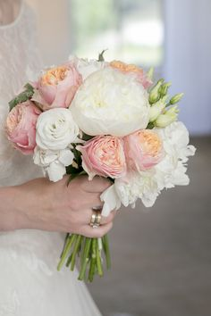White and peach wedding bouquet.