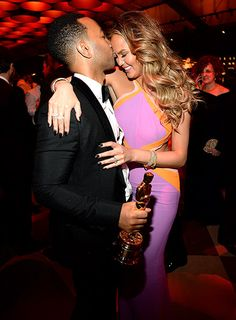 """John Legend kissed his wife Chrissy Teigen at the Vanity Fair party after winning an Oscar for his original song """"Glory."""""""