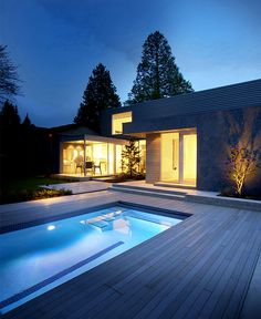 Canadian Holiday #House with Clear Architectural Lines - pool area with beautiful deck