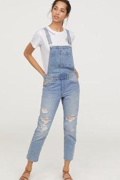 Bib overalls in washed denim with heavily distressed details. Adjustable suspenders bib pocket, and buttons at sides. Side pockets, back p Light Denim, Light Blue Jeans, Blue Denim, Washed Denim, Jean Overall Outfits, Denim Claro, T Shirt Hacks, Estilo Jeans, Denim Overalls