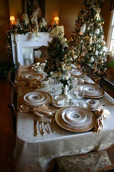 Christmas table setting. Christmas tree, candles, and table set the atmosphere. So beautiful!