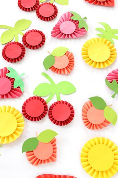 take a basic craft technique and turn it into something party worthy! This easy DIY summer fruit paper rosettes are showstoppers and simple to create.