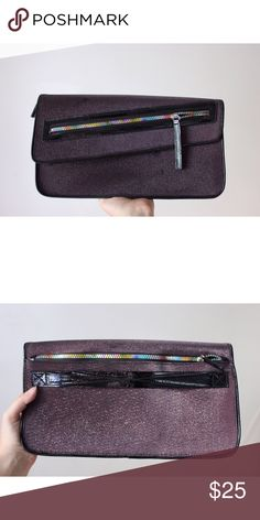 Urban Outfitters galactic clutch Silvery metallic clutch with asymmetrical flap and rainbow zippers. Has a patent strap on the back for your wrist. 3 inside pockets. Has some unnoticeable stains across the front. Fantastic condition, very unique. Urban Outfitters Bags Clutches & Wristlets
