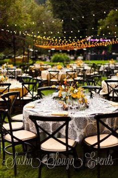 Overhead bare bulb string lights lead from dinner to dancing. Image by @Julie Forrest Hamilton #wedding #reception #stringlights #country #yellow