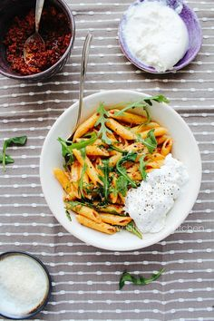 Penne with sun-dried tomato, red chilli and walnut pesto, rocket and burrata