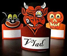 These vintage villain-inspired place cards are an excellent touch to your Halloween feast and can even double as napkin holders.