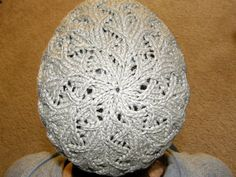 This hat arose from a simple desire to turn a favorite stitch pattern into a hat. The decreases for the crown produced unexpectedly delightful results!  Charts included in pattern