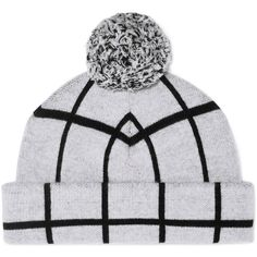 rag   bone s merino wool  Mallori  beanie is knitted in a double layer for  extra warmth and softness. This dove-gray and black checked style is topped  with ... ef999179c527