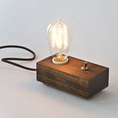 Andrew Berg LampThis wonderful simple design for a modern and rustic lamp is completed with a good wood finish and simple 75 watt lightbulb, found via MCHL