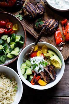 A simple tasty recipe for Grilled Greek Souvlaki Bowl with Cauliflower Rice, flavorful Cucumber Yogurt Sauce and fresh summer vegetables.