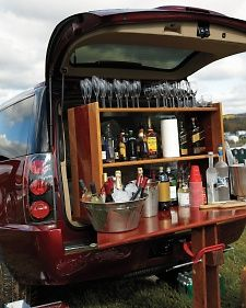 Tailgating Goes Upscale: Don't think I will ever need a full bar at a tailgate, but the wood-work table and shelf looks to be an easy build or recycle. Love the idea for a portable spread! Tailgate Bar, Football Tailgate, Football Food, Football Season, Tailgating Ideas, Tailgate Parties, Fall Football, Football Parties, Picnic Parties