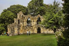 St. Mary's Abbey, York.    The Abbey of St Mary in York, once the richest abbey in the north of  England,  is a ruined Benedictine abbey that lies in what are now the  Yorkshire Museum Gardens, on a steeply sloping site, to the west of  York Minster. The original abbey on the site was founded in 1055.