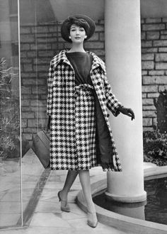 Simone d'Aillencourt in navy and white houndstooth coat and skirt with navy jersey top by Jacques Heim, hat by Svend, purse by Durer, photo by Pottier, 1958