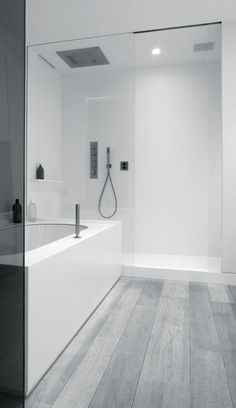 Grey tiled flooring white wall tile bathroom