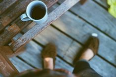 leah gray:  photo of coffee on a porch.