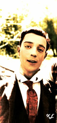 Buster Keaton smiling! And such a nice colourization :)