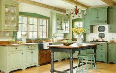 Gorgeous Green Kitchens. I like eclectic, so would add my red and yellow and blue.