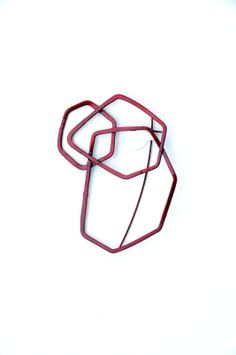 red powder coated brooch by @Luis Enciso Studio