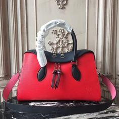 7a2036521cbc Louis Vuitton Epi Leather Tuileries Red is made of Epi