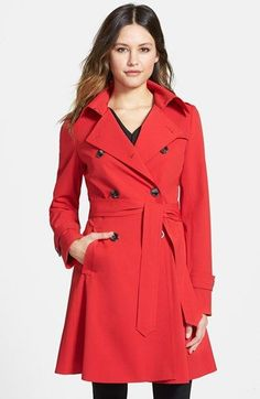 Free shipping and returns on Trina Turk 'Juliette' Double Breasted Skirted Trench Coat at Nordstrom.com. A weather-tough twill trench with iconic details gets a ladylike spin in a fit-and-flare silhouette wrapped with a tie belt.