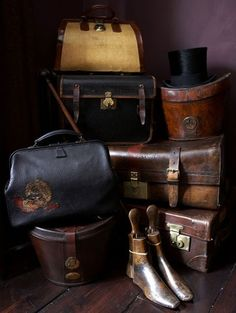 A Collection of Vintage Leather Luggage including TwoTop Hat Boxes, One Top Hat & a Pair of Polished Wooden Shoe Trees ....