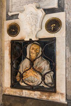 """""""Neque illic Mortuus"""", lower part of monument to Giovani Baptista Gisleni (1670) in the Basilica of Santa Maria del Popolo, Rome, Italy."""