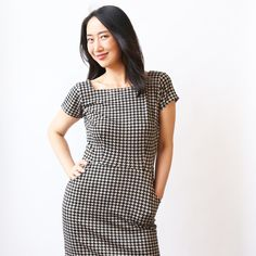 this short sleeve tailored dress has pockets. the patti has a square neck which is slightly lower in the back. this dress with pockets has a pencil skirt at knee length. machine wash cool, hang dry, no ironing ever needed! the patti is an american made dress crafted with love in Brooklyn, NY