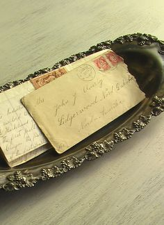 Old love letter in silver tray.