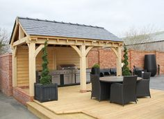 A BBQ/CookHouse on decking. Slate roof.