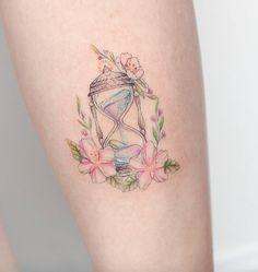 Feminine hourglass tattoo by Hello Tattoo