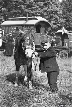 A young gypsy boy with hsi Shetland pony at Epsom Derby in 1930