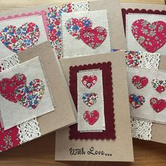 Handmade liberty tana lawn greetings card suitable for Valentines Day, Mothers day, an anniversary or thank you card. The applique hearts have been die cut out of liberty tana lawn fabric and are then hand-stitched to a vintage linen background. This is then mounted on a 5 square