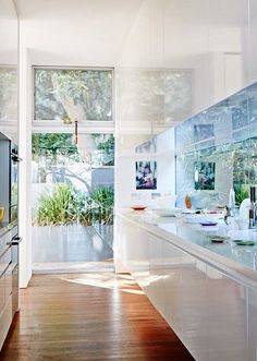 Inside-outside. loving the glass window splashback in this kitchen. Best of Australian Homes 2014 · Louise Olsen, Stephen Ormandy and Family — The Design Files Kitchen Interior, Kitchen Inspirations, House Design, Interior, Home, House Styles, House Interior, Home Kitchens, Kitchen Style