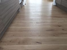 Mocca. Engineered oak wooden floors.  Light smoked oak, sanded, hardwax oiled.   Wooden floors for commercial and residential projects.