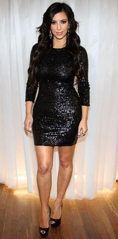 Look of the Day › November 4, 2010 WHAT SHE WORE Kardashian celebrated the opening of her third Dash store in a formfitting Alice + Olivia by Stacey Bendet sequin minidress and peep-toe platform heels. WHY WE LOVE IT Va-va-va-voom! Kardashian worked her curves in this little number, while three-quarter length sleeves and a modest neckline revealed just the right amount of skin.