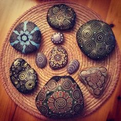 Different and beautiful mandalas, painted on stone!