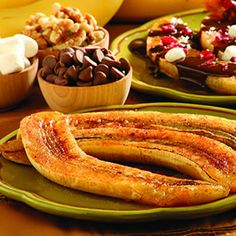 Baked Cinnamon Bananas :)  1 Ripe Banana, peeled and sliced lengthwise  Lemon Juice  2 tsp. Honey  Ground Cinnamon  Line toaster oven tray with nonstick aluminum foil.Lightly brush banana halves with lemon juice. Spoon honey over banana halves and sprinkle lightly with cinnamon. Bake for 10 minutes at 350. Remove from oven; cut into 1-inch pieces. Can top with chocolate chips, fruit, etc. if you like.