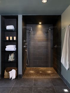 Color palette for restrooms: dark highly textured tile on walls and floor, gray paint