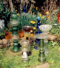 """glass garden art..use those strange, ugly, unloved bottles, bowls and plates and make something unique.. """"Goop"""" (household goop) is the glue that stands up to any weather..even freezing"""