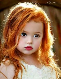 Lovely child                            I Love The Color of Her RED HAIR.