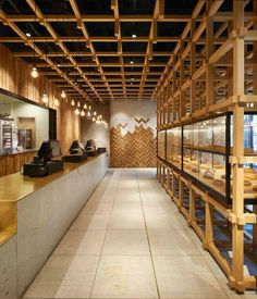 Repurposed timber is the material of choice forming a mural shaped to evoke a field of wheat at a Beijing bakery by Chinese firm B.L.U.E. Architecture.:Ruijing Photo. @sandow - Architecture and Home Decor - Bedroom - Bathroom - Kitchen And Living Room Int