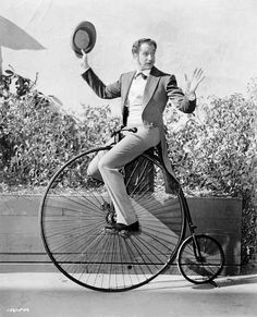 Vincent Price on an early bicycle model. Only Vinnie could pull this off with such style.