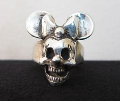 Uh Minnie... Is that you?  Minnie Mouse Skull Ring designed by Takahashi Toshi